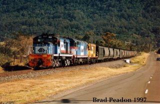 103 leads a mixed consist on a coal train ex Wongawilli
